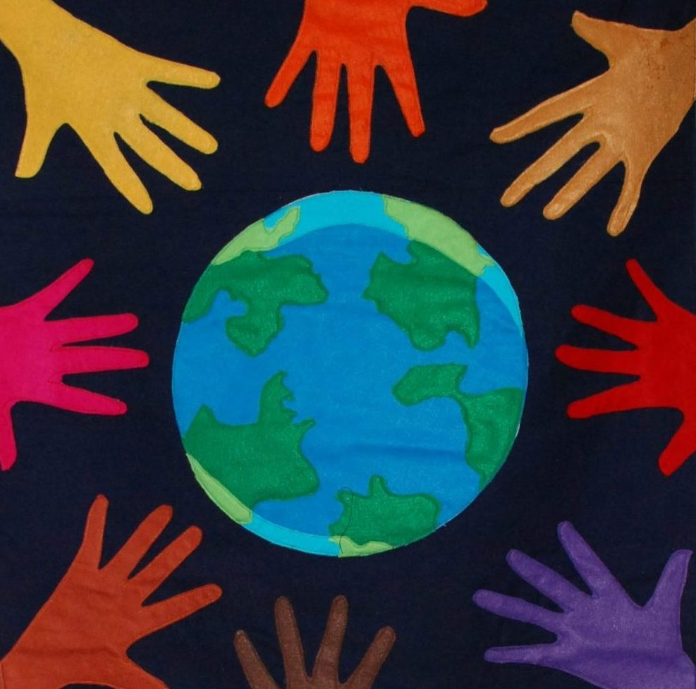 Hands around earth image