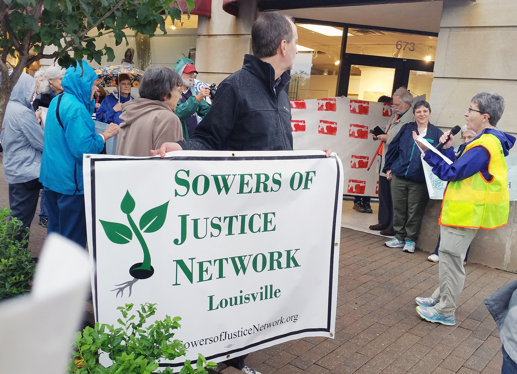 At right, Pat Geier speaks to participants in a prayerful march for solutions to gun violence. The march was led by the Sowers of Justice Network May 21 in Louisville. (Photo courtesy of Pat Geier)