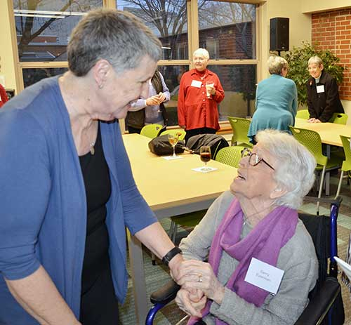 Gerry Eyerman, right, congratulates Barbara Roche on the dedication of the Barbara Roche SL Library at Nerinx Hall. (Photo by Jean M. Schildz)