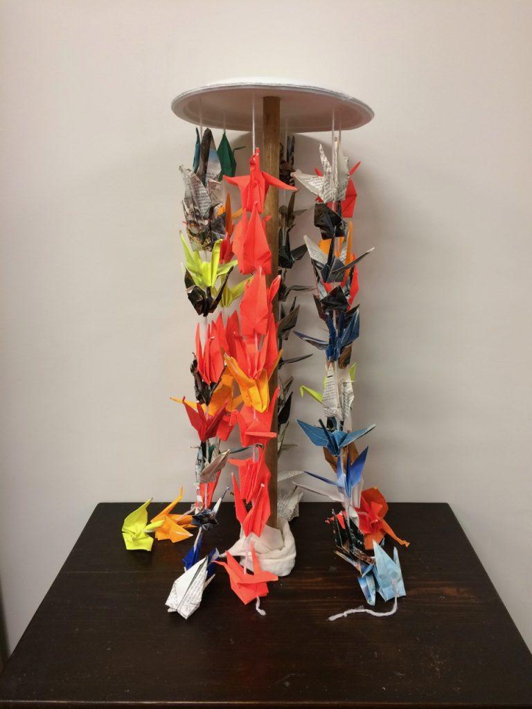 Display of strings of origami cranes