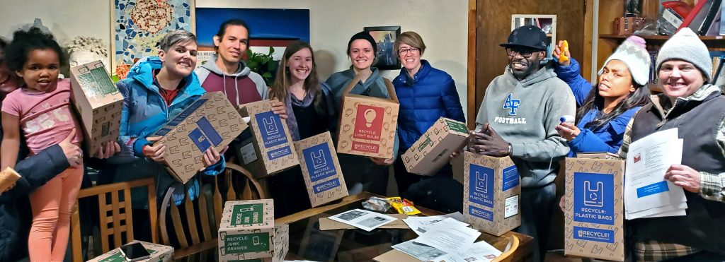 Group of people holding boxes