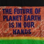 """Banner reading """"The future of planet Earth is in our hands."""""""
