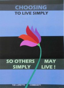 "Handmade banner with flower and the following text ""Choosing to live simply so others may simply live!"""