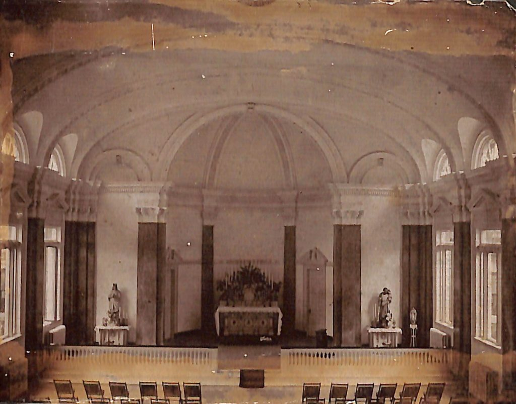 Historical photo of simple interior of chapel.