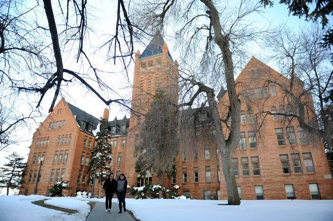 Two students walking on a winter campus
