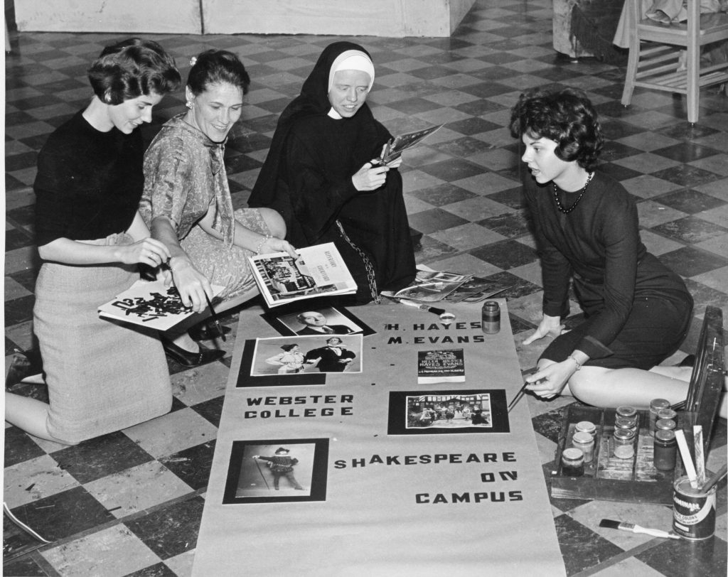 Archival photo of Loretto sister making a poster with students