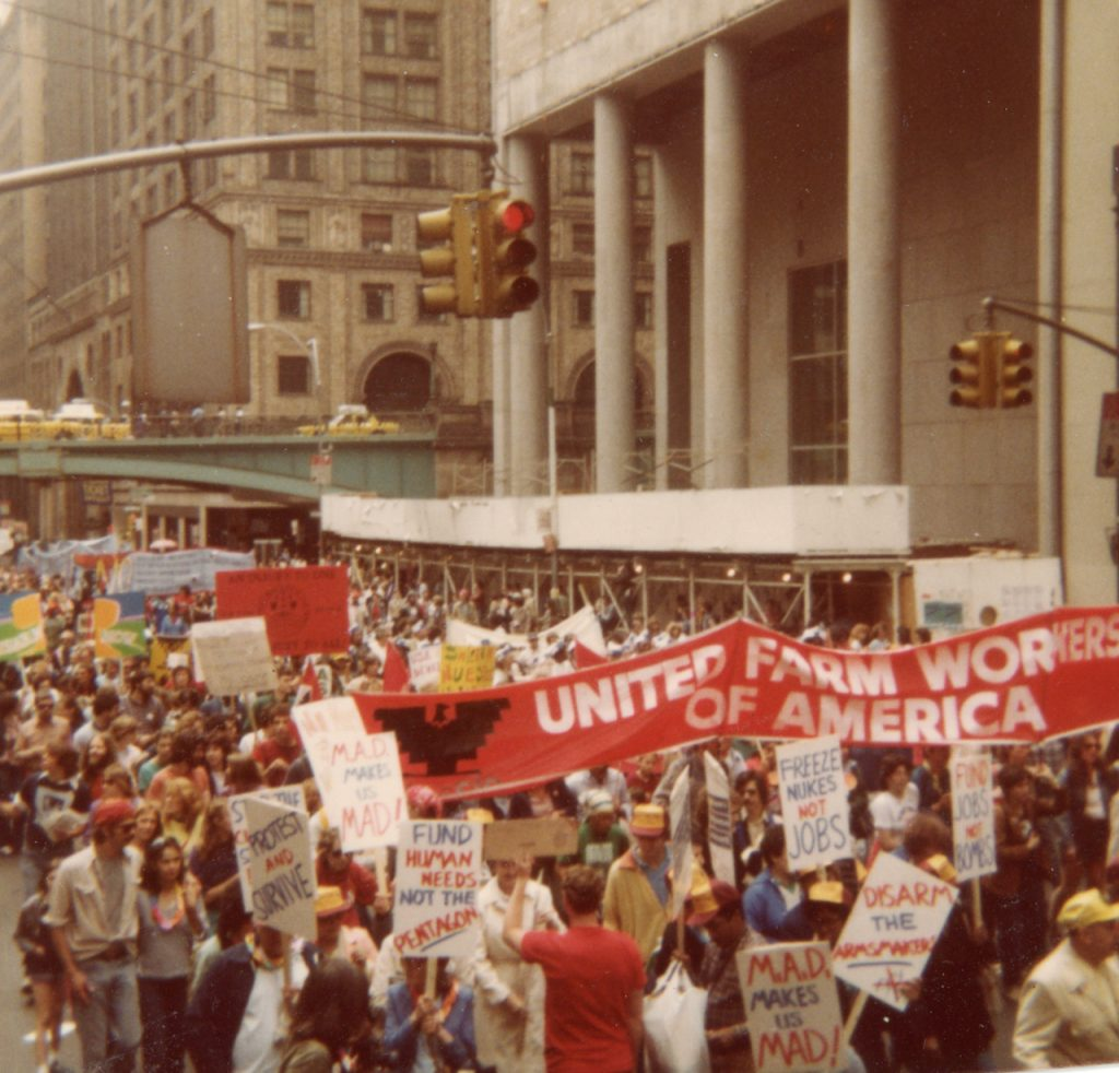 """Protest march with people carrying a banner reading """"United Farm Workers of America"""""""