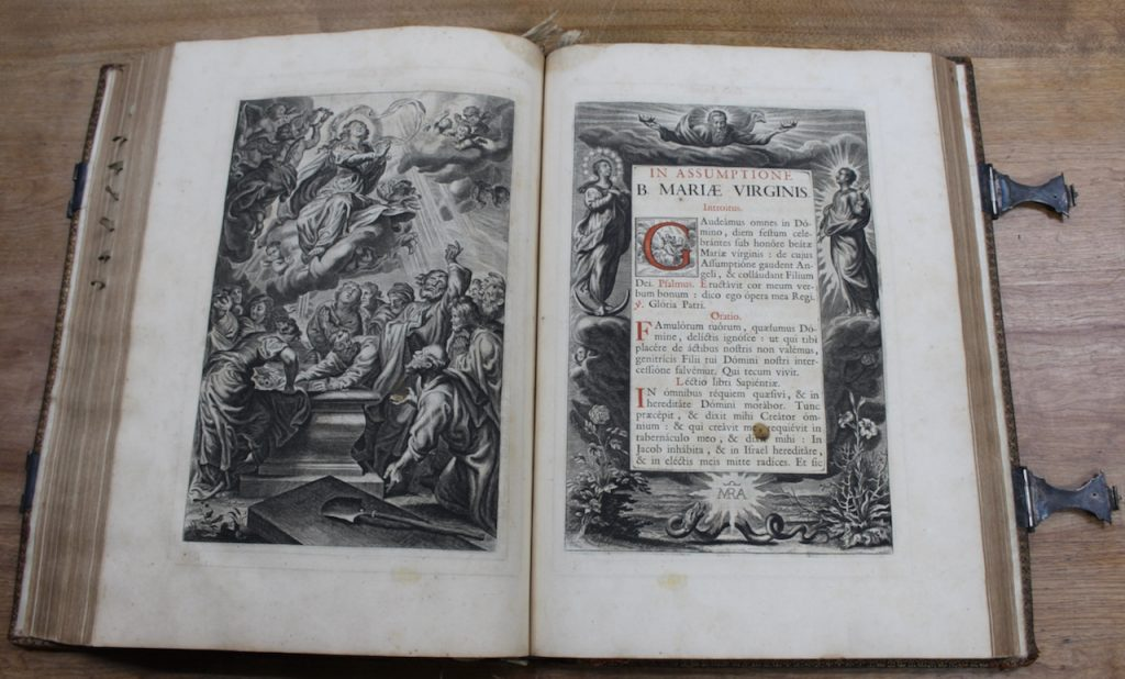 Two pages of an antique book displaying biblical images and text.