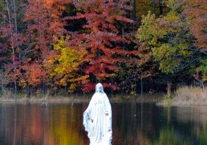 A photo of the statue of Mary, St. Mary's Lake on the Motherhouse grounds