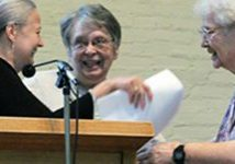 From left, Earna Volk presents her co-membership commitment to Loretto President Barbara Nicholas, center, receiving congratulations from Barbara and Agnes Ann Schum.