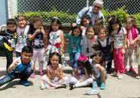 Kathy Wrights joins a happy group of Belga School preschoolers.