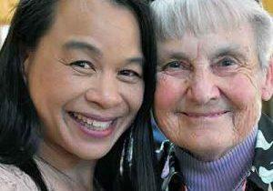 A photo of Vietnam adoptee Tobi Garrett with Mary Nelle Gage SL
